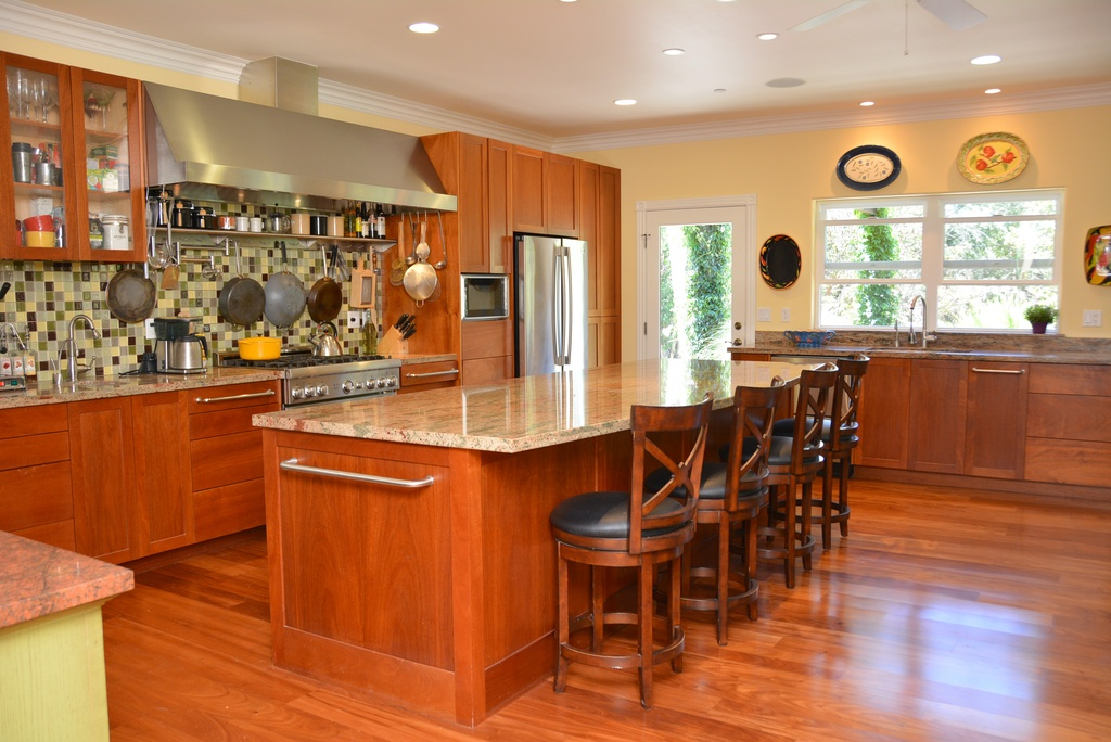 the open plan has a custom kitchen design by the client